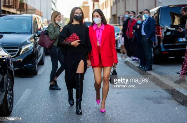 Evangelie Smyrniotaki wearing black dress, bordeaux bag and Tiffany Hsu wearing red blazer, mini skirt, purple cropped button shirt seen outside...