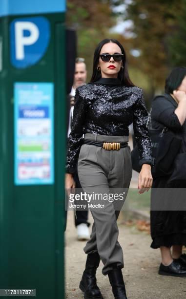 Evangelie Smyrniotaki wearing Elie Saab top and Bottega Veneta boots and mini bag on September 28, 2019 in Paris, France.