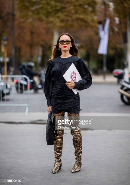Evangelie Smyrniotaki wearing golden overknees boots black dress is seen outside Chanel during Paris Fashion Week Womenswear Spring/Summer 2019 on...