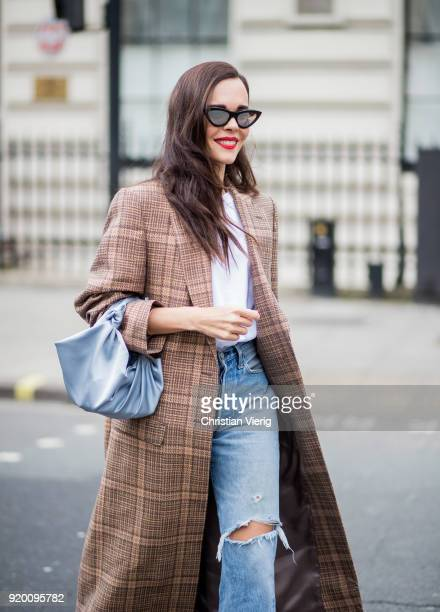 Evangelie Smyrniotaki wearing plaid brown coat, ripped denim jacket seen outside Delpozo during London Fashion Week February 2018 on February 18,...
