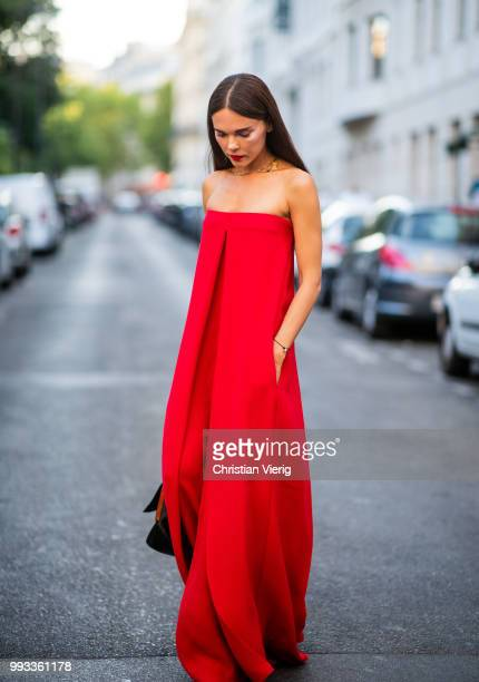 Evangelie Smyrniotaki wearing red off shoulder overall seen outside Valentino on day four during Paris Fashion Week Haute Couture FW18 on July 4 2018...