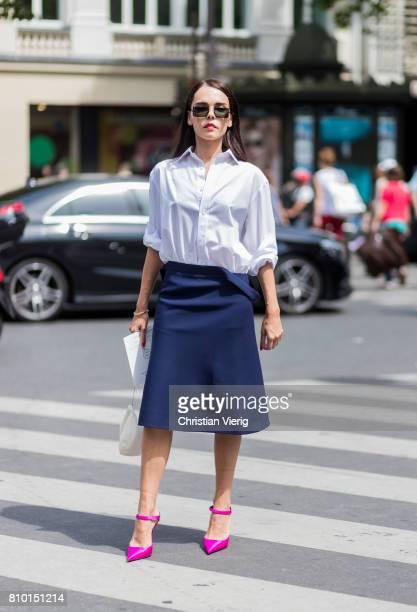 Evangelie Smyrniotaki wearing white blouse, navy skirt, pink heels outside Elie Saab during Paris Fashion Week - Haute Couture Fall/Winter 2017-2018...