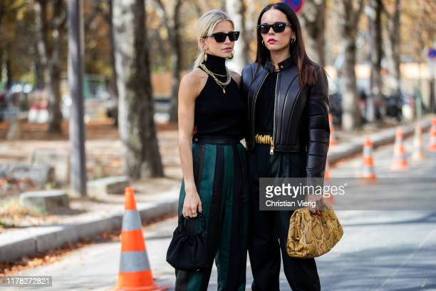 Evangelie Smyrniotaki wearing yellow Bottega Veneta pouch bag with snake print black leather jacket and Caroline Caro Daur wearing sleeveless black...