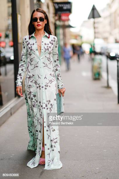Evangelie Smyrniotaki wears a green flower print dress outside the Valentino show during Paris Fashion Week Haute Couture Fall/Winter 20172018 on...