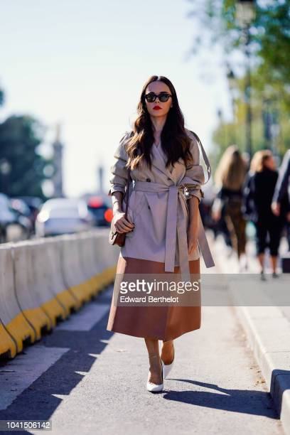 Evangelie Smyrniotaki wears a trench coat outside Margiela during Paris Fashion Week Womenswear Spring/Summer 2019 on September 26 2018 in Paris...
