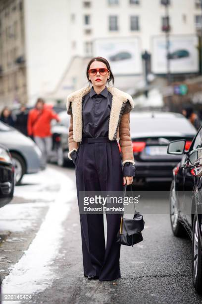 Evangelie Smyrniotaki wears an aviator jacket black pants a bag during Paris Fashion Week Womenswear Fall/Winter 2018/2019 on March 1 2018 in Paris...