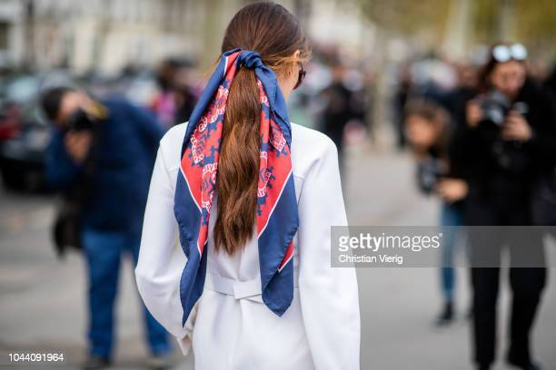 Evangelie Smyrniotaki with a scarf in her hair wearing white Valentino dress with belt is seen outside Valentino during Paris Fashion Week Womenswear...