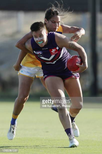 Evangeline Gooch of the Dockers is tackled by Tarnee Tester of the Eagles during a pre-season AFLW match between the West Coast Eagles and the...
