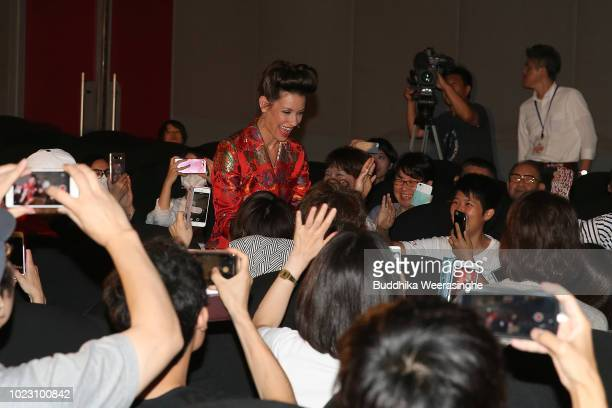 Evangeline Lilly greets fans upon arriving at the 'AntMan And The Wasp' premiere on August 23 2018 in Osaka Japan