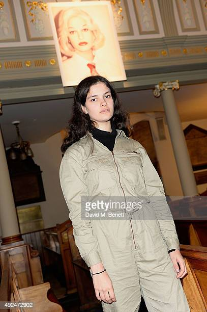 Evangeline Ling with her artwork as she attends a private view of Take Eat curated by Diana Chire and MC Llamas at St Marylebone Parish Church on...