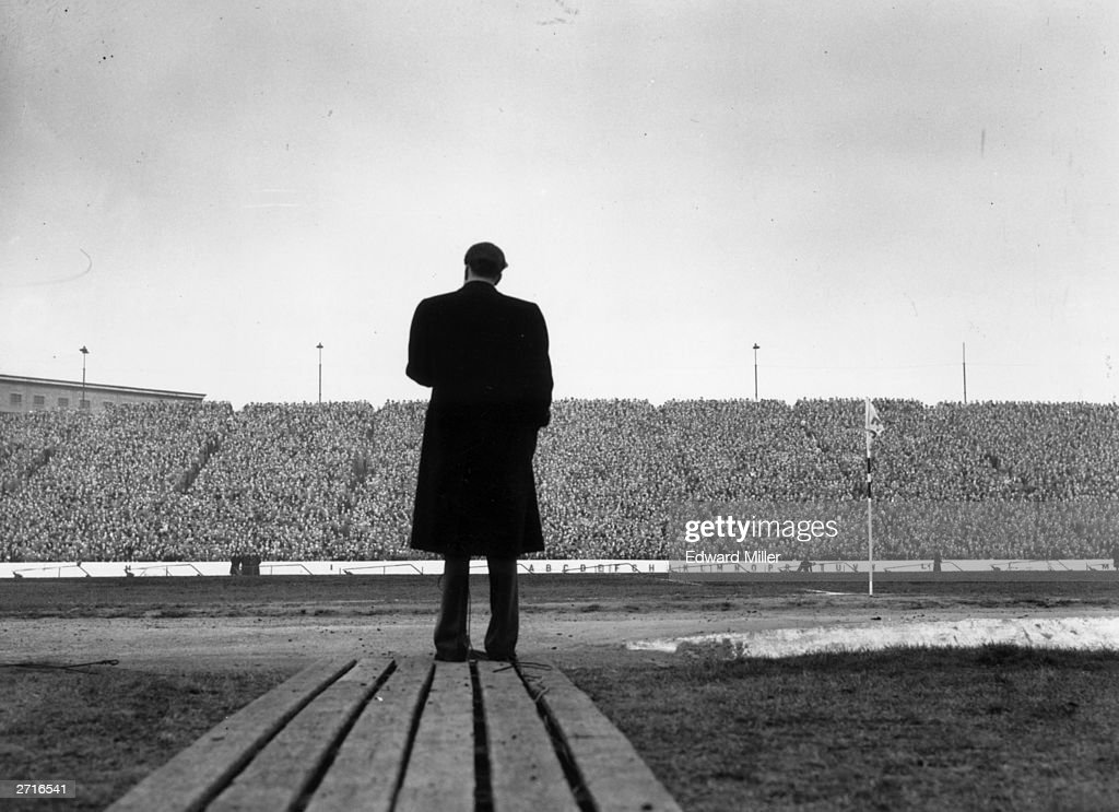 US evangelist Billy Graham addresses a crowd of football supporters at Stamford Bridge, London, during half-time at the match between Chelsea and Newcastle United.