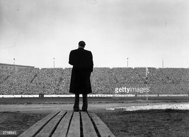 US evangelist Billy Graham addresses a crowd of football supporters at Stamford Bridge London during halftime at the match between Chelsea and...