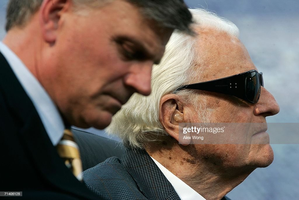 Evangelist Billy Graham (R) and his son Franklin (L) take part in the Metro Maryland 2006 Festival July 9, 2006 at Oriole Park at Camden Yards in Baltimore, Maryland. Franklin Graham led the three-day-program filled with music, prayers and gospel messages.