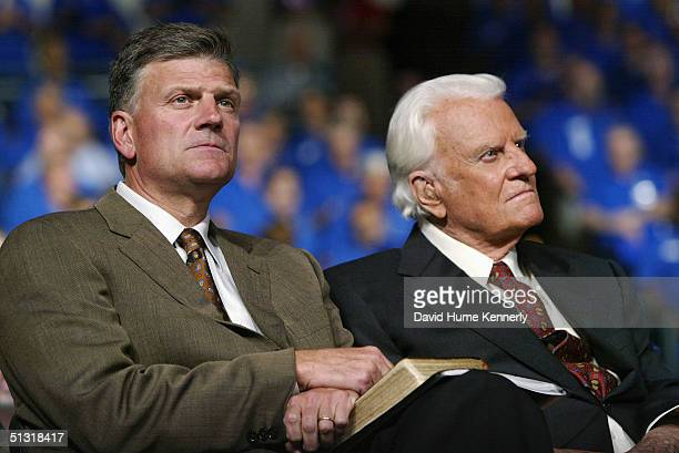 Evangelist Billy Graham and son Reverend Franklin Graham look on at a Billy Graham rally on June 12 2003 in Oklahoma City Oklahoma