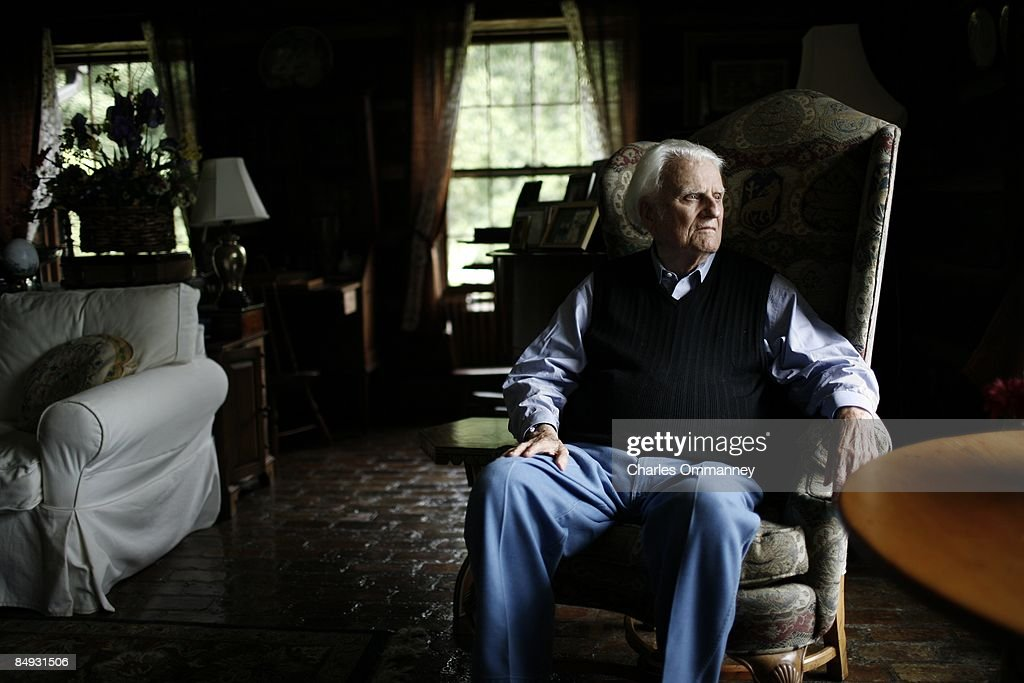 Evangelist Billy Graham at his home in the mountains of Montreat, July 25, 2006 near Asheville, North Carolina. Billy and Ruth Graham see out their days reading, watching the latest news and playing with their dogs, Paula (white), China and Theo at the Little Piney Cove homestead, where the Blue Ridge meets the Black Mountain range east of Asheville.