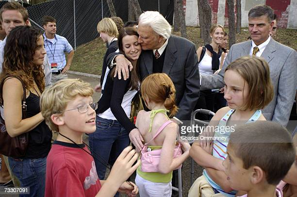 Evangelist Billy Graham greets followers during his New York Crusade at Flushing Meadows Park on June 24 2005 in Queens New York Graham has preached...