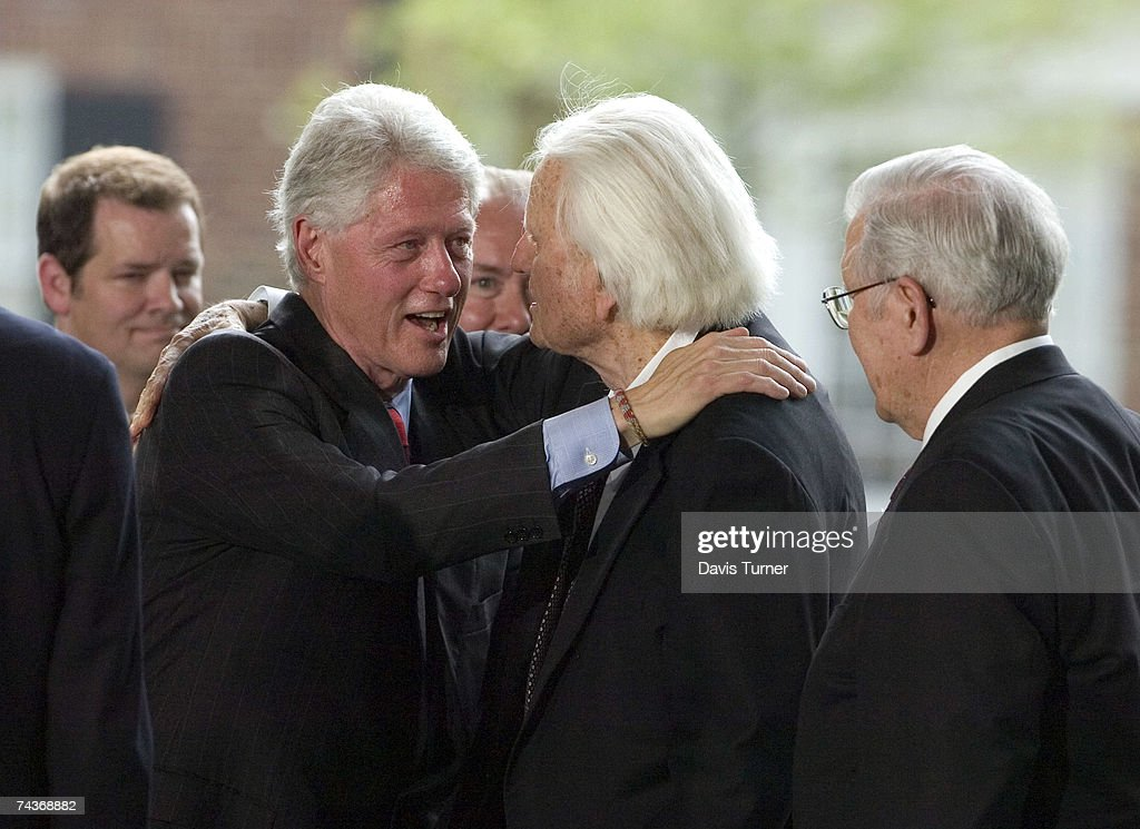 Evangelist Billy Graham (C) is greeted by former U.S. President Bill Clinton (L) on the stage during the Billy Graham Library Dedication Service on May 31, 2007 in Charlotte, North Carolina. Approximately 1500 guests attended the private dedication ceremony for the library, which chronicles the life and teachings of Graham. Former U.S. Presidents Bill Clinton, Jimmy Carter and George H.W. Bush made short speeches during the dedication ceremony.