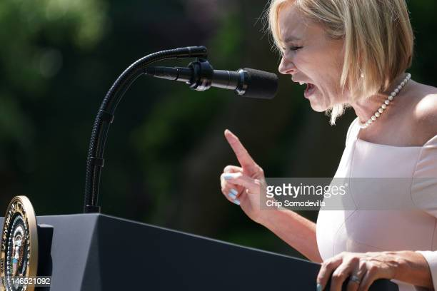 Evangelist Paula White, chair of the White House evangelical advisory board, says a prayer for U.S. President Donald Trump during a National Day of...
