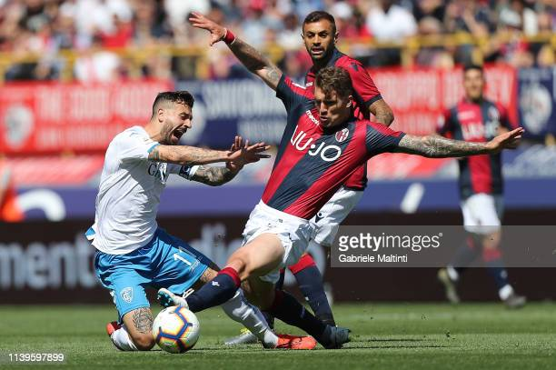 Evangelista Lyanco of Bologna FC battles for the ball with Francesco Caputo of Empoli FC during the Serie A match between Bologna FC and Empoli at...