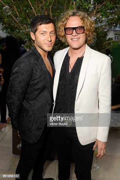 Evangelo Bousis and Peter Dundas attend amfAR Paris Dinner 2018 at The Peninsula Hotel on July 4 2018 in Paris France