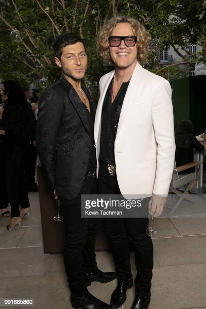 Evangelo Bousis and Peter Dundas attend the amfAR Paris Dinner at The Peninsula Hotel on July 4 2018 in Paris France