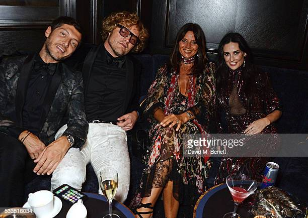 Evangelo Bousis Peter Dundas Countess Debonnaire von Bismarck and Demi Moore attend British Vogue's Centenary birthday party at Tramp on May 23 2016...