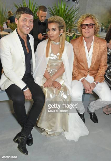 Evangelo Bousis Sheikha Aisha Al Thani and Peter Dundas attend the Fashion for Relief cocktail party during the 70th annual Cannes Film Festival at...