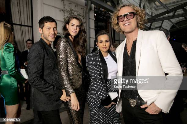 Evangelo Bousis Vanessa Moody Sheikha Aisha and Peter Dundas attend the amfAR Paris Dinner at The Peninsula Hotel on July 4 2018 in Paris France