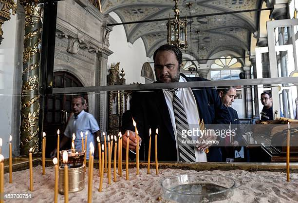 Evangelos Marinakis president of Olympiacos FC light a candle during his visit to Patriarch Bartholomew at Ecumenical Patriarchate ahead of a...