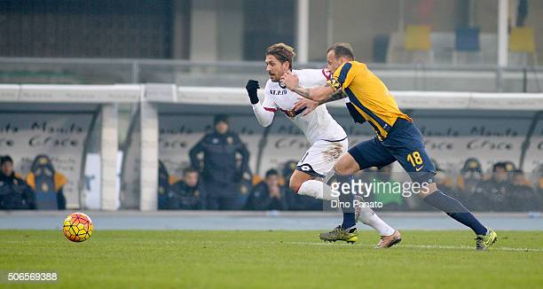 Evangelos Moras of Hellas Verona compets with Alessio Cerci of Genoa CFC during the Serie A match between Hellas Verona FC and Genoa CFC at Stadio...