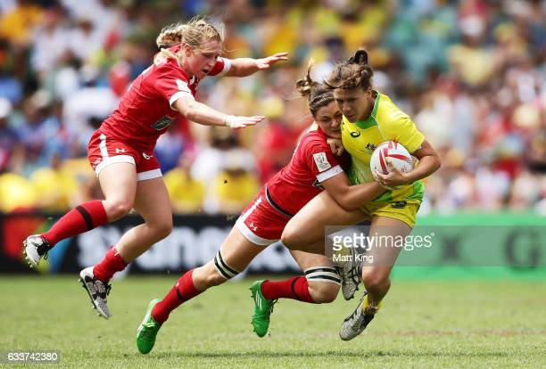 Evania Pelite of Australia is tackled during the womens semi final match between Australia and Canada in the 2017 HSBC Sydney Sevens at Allianz...