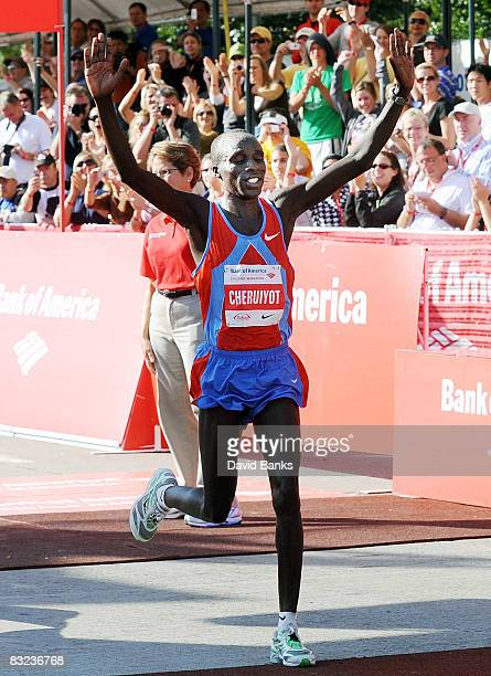 Evans Cheruiyot of Kenya crosses the finish line to win The Bank of America Chicago Marathon October 12 2008 in Chicago Illinois David Mandago of...