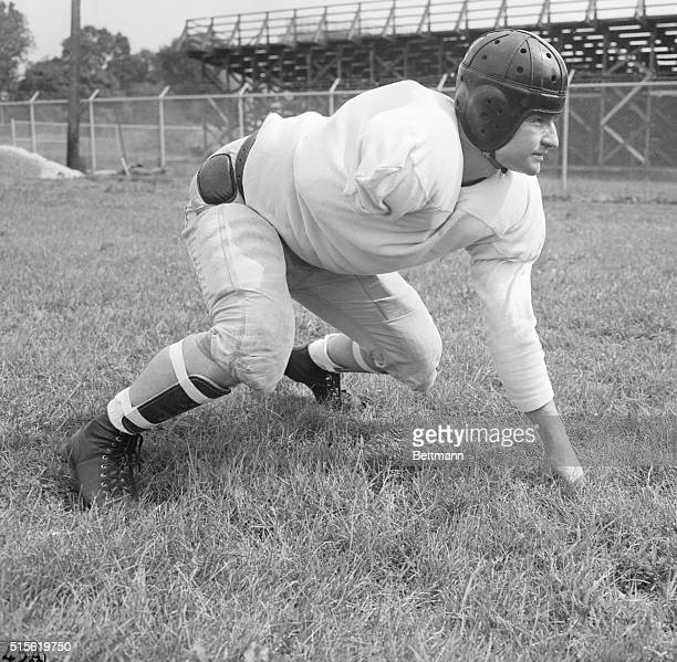 8/14/1945 Evanston IL Onearmed Tulsa guard Ellis Jones is back for first line scrimmage practice at Dyche Stadium Evansont where the AllStars are...