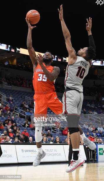 Evansville Purple Aces forward John Hall shoots over Illinois State Redbirds forward Phil Fayne during a Missouri Valley Conference Basketball...