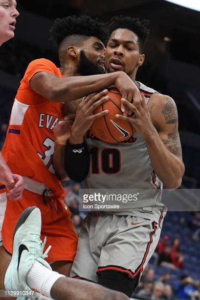 Evansville Purple Aces forward John Hall ties up Illinois State Redbirds forward Phil Fayne during a Missouri Valley Conference Basketball Tournament...
