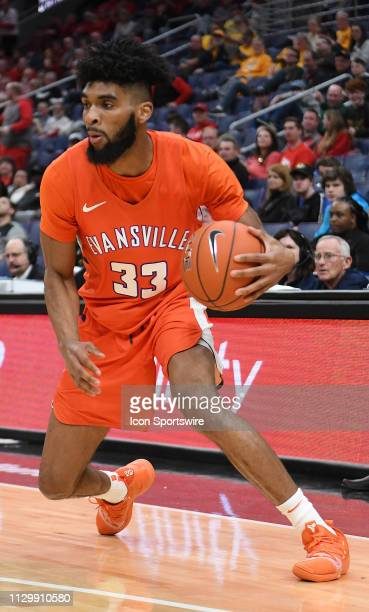 Evansville Purple Aces guard KJ Riley with the ball during a Missouri Valley Conference Basketball Tournament game between the Evansville Purple Aces...