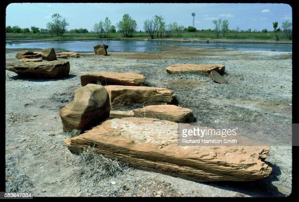 evaporating prairie pond with rocks - retreating ストックフォトと画像