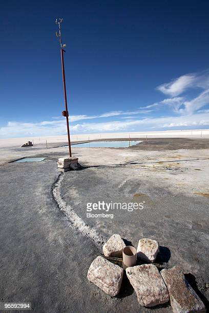 Evaporation pools designed for isolating lithium sit in the distance at the Uyuni Salt Flat in Uyuni Bolivia on Nov 18 2009 The salt flat is the...