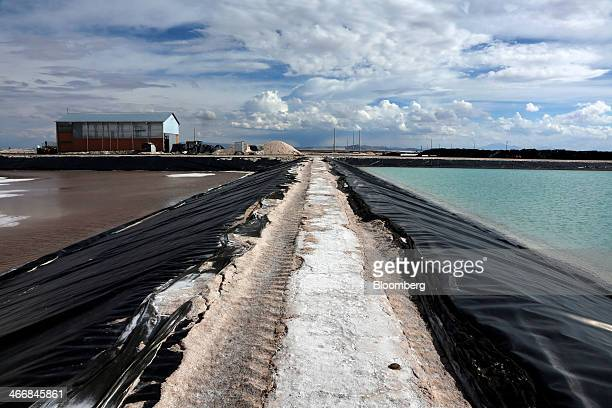Evaporation pools where lithium bicarbonate is isolated from salt brine during the process of lithium production are separated by a narrow strip of...
