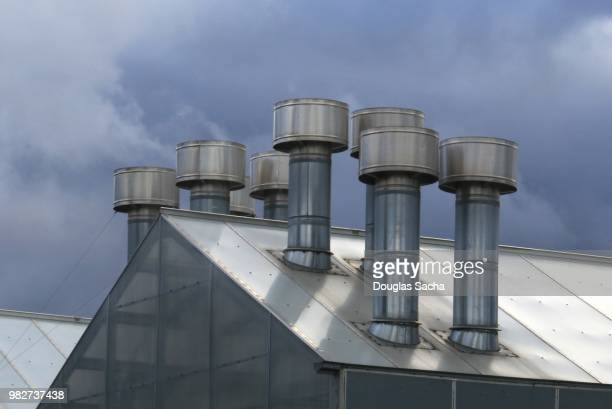 Evaporator Cooling vent stacks on an agricultural green house