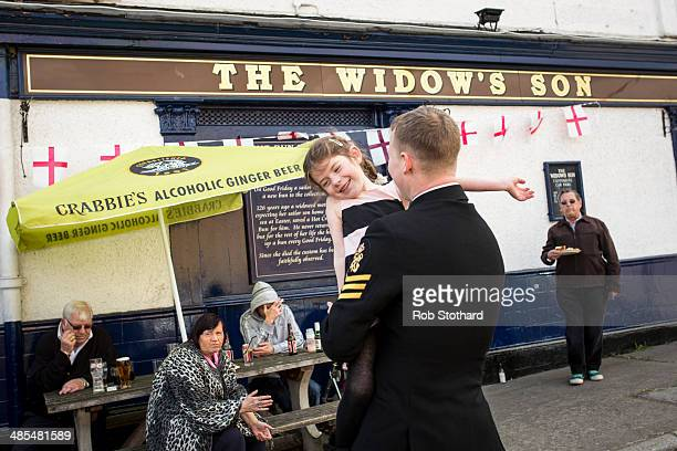 Eve Allen dances with her father Petty Officer Darbz Allen outside the Widow's Son pub in BromleybyBow on April 18 2014 in London England The Widow's...