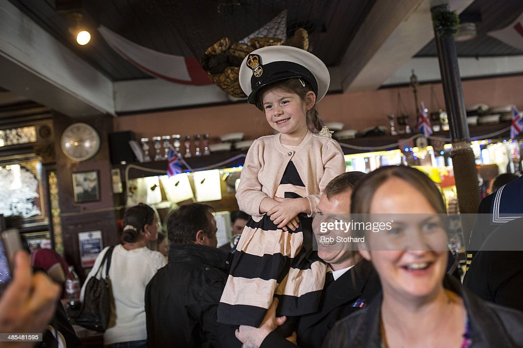 Eve Allen wears her father Petty Officer Darbz Allen's hat inside the Widow's Son pub in Bromley-by-Bow on April 18, 2014 in London, England. The Widow's Son was built in 1848 upon the former site of an old widow's cottage who, when her only son left to be a sailor, promised to bake him a Hot Cross Bun and keep it for his return. The son never returned but the widow refused to give up hope, baking a fresh one each year. This annual tradition has been continued in the pub as a remembrance of the widow and her son, and of the bond between all those on land and sea, with sailors of the Royal Navy coming to place the bun in a net above the bar.