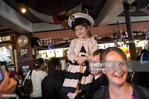 Eve Allen wears her father Petty Officer Darbz Allen's hat inside the Widow's Son pub in BromleybyBow on April 18 2014 in London England The Widow's...
