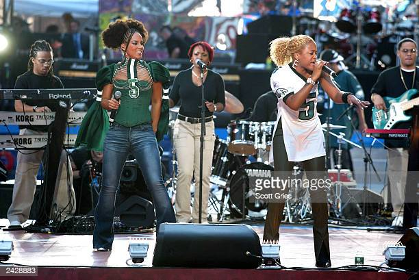 Eve and Alicia Keys perform at'Coutdown to Kickoff The NFL Times Square Concert' to celebrate the opening of the 2002 NFL season in Times Square New...