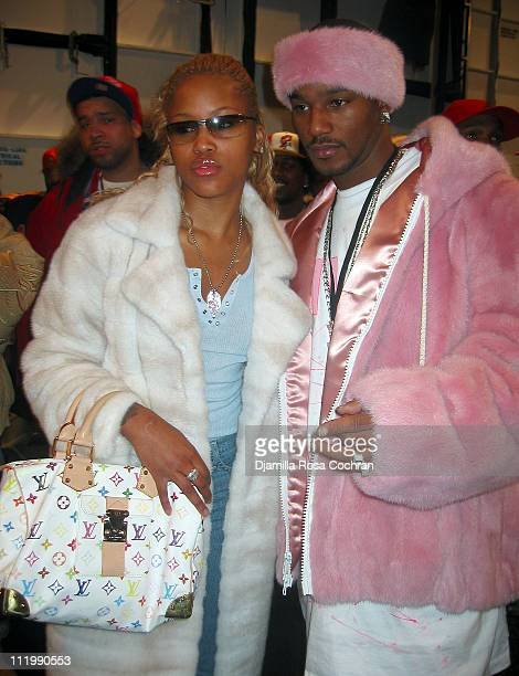 Eve and Cam'ron during Mercedes-Benz Fashion Week Fall 2003 Collections - Baby Phat - Front Row and Backstage at Bryant Park in New York City, New...
