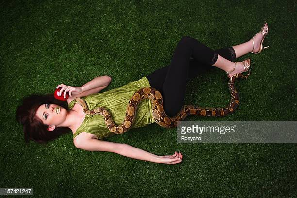 eve and the serpent - boa constrictor stock photos and pictures
