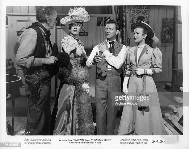 Eve Arden, Donald O'Connor and Gale Storm standing before unidentified man in a scene from the film 'Curtain Call At Cactus Creek', 1950.