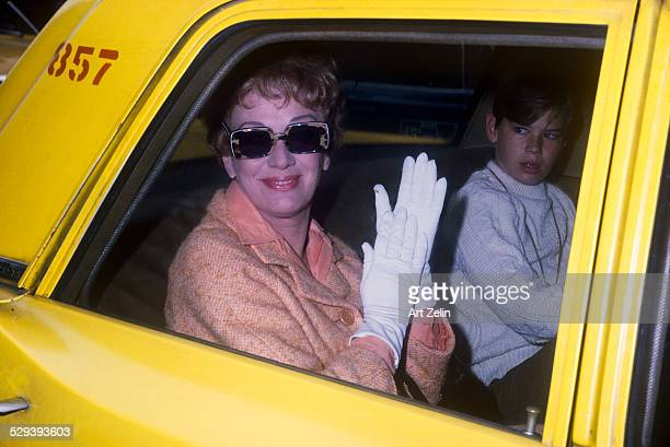 Eve Arden with her son Douglas Brooks West in taxi circa 1949 New York