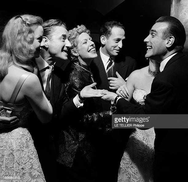 Eve At The Elysee Club And At The Admiral. Paris, 31 décembre 1955, soirée de réveillon à l'Elysée Club. Claude DAUPHIN tenant par la taille une...