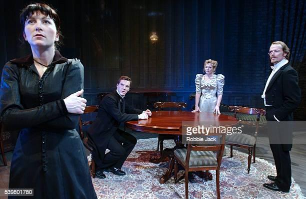 Eve Best as Hedda Tesman Benedict Cumberbatch as George Tesman Lisa Dillon as Thea Elvsted and Iain Glen as Judge Brack in Henrik Ibsen's Hedda...